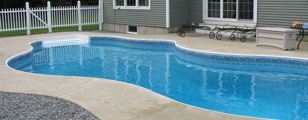 Inground pool Lagoon Make Carnahan Landscaping Maine Pool Company Inground And Above Ground Pools Pool Chemicals